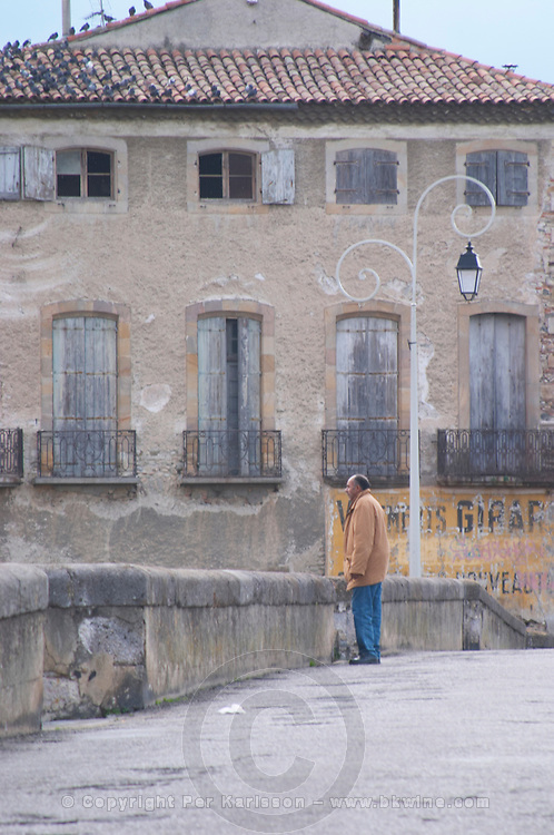 the bridge across the l'Aude river with a man standing on the bridge. Town of Limoux. Limoux. Languedoc. France. Europe.