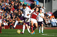 Everton's Samuel Eto'o tackles Burnley's Scott Arfield.Barclays Premier league match, Burnley v Everton at Turf Moor in Burnley, Lancs on Sunday 26th October 2014.<br /> pic by Chris Stading, Andrew Orchard sports photography.