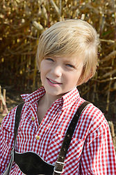 Boy in cornfield, Bavaria, Germany