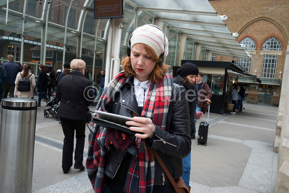 Woman engrossed in reading her iPad at Liverpool Street in London, England, United Kingdom. (photo by Mike Kemp/In Pictures via Getty Images)