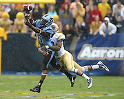 ATLANTA, GA - SEPTEMBER 21:  Cornerback Louis Young #8 of the Georgia Tech Yellow Jackets defends a pass against wide receiver Sean Tapley #6 of the North Carolina Tar Heels during the game at Bobby Dodd Stadium at Historic Grant Field on September 21, 2013 in Atlanta, Georgia.  (Photo by Mike Zarrilli/Getty Images)