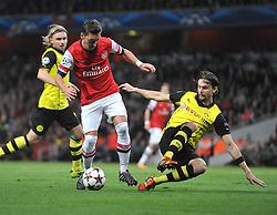 Borrusia Dortmund's Neven Subotic tackles Arsenal's Mesut Ozil inside the box - Photo mandatory by-line: Alex James/JMP - Tel: Mobile: 07966 386802 22/10/2013 - SPORT - FOOTBALL - Emirates Stadium - London - Arsenal v Borussia Dortmund - CHAMPIONS LEAGUE - GROUP F
