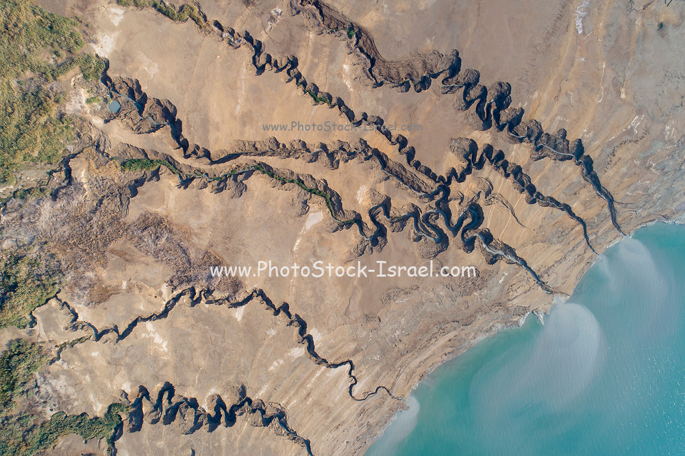 Aerial Photography with a drone. Elevated view of the shore of the Dead Sea, Israel. The flash flood water has dug ravines in the shore