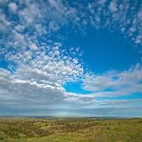 Clouds float over the Missouri River Breaks and Charles M. Russell National Wildlife Reserve in Montana.