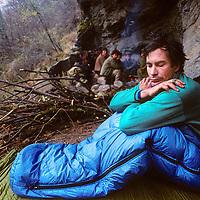 TIBET, Tsangpo Gorge, David Breashears wakes to rain in Himalayan cave below Mt.Namche Barwa(porters bkg