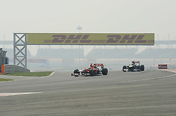 29.10.2011, Jaypee-Circuit, Noida, IND, F1, Grosser Preis von Indien, Noida, im BildDHL Branding - Timo Glock (GER), Marussia Virgin Racing // during the Formula One Championships 2011 Large price of India held at the Jaypee-Circui 2011-10-29  EXPA Pictures © 2011, PhotoCredit: EXPA/ nph/  Dieter Mathis       ****** out of GER / CRO  / BEL ******