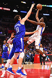 October 19, 2018 - Los Angeles, CA, U.S. - LOS ANGELES, CA - OCTOBER 19: Oklahoma City Thunder Guard Hamidou Diallo (6) is fouled by Los Angeles Clippers Center Boban Marjanovic (51) during a NBA game between the Oklahoma City Thunder and the Los Angeles Clippers on October 19, 2018 at STAPLES Center in Los Angeles, CA. (Credit Image: © Brian Rothmuller/Icon SMI via ZUMA Press)