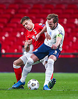 LONDON, ENGLAND - MARCH 31: Jan Bednarek of Poland competes with Harry Kane of England during the FIFA World Cup 2022 Qatar qualifying match between England and Poland on March 31, 2021 in London, United Kingdom. Sporting stadiums around the UK remain under strict restrictions due to the Coronavirus Pandemic as Government social distancing laws prohibit fans inside venues resulting in games being played behind closed doors. (Photo by Wlosek/PressFocus/MB Media)