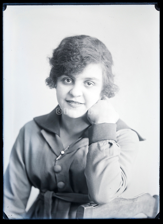 smiling  happy young adult woman with big wide open eyes looking at the camera circa 1920s
