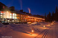 Cross country ski track lit at dusk by Grouse Mountain Lodge in Whitefish, Montana, USA