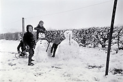 children making snowman 1960s