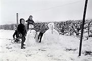 children making snowman 1960s