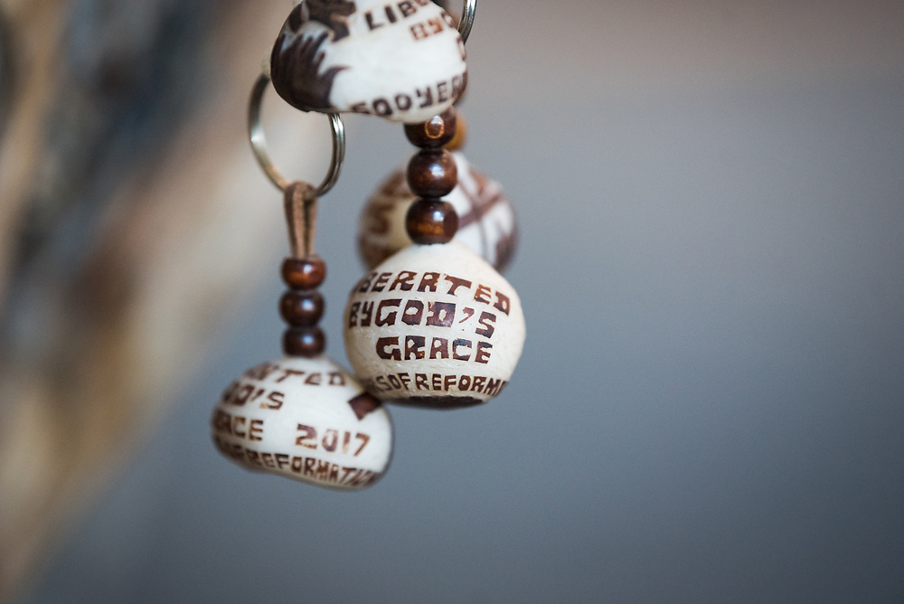"""10 May 2017, Windhoek, Namibia: Namibian Makalani nuts, traditionally made from dried fruits of a Palm tree. Here, engraved with the words """"Liberated by God's Grace"""", the theme of the Lutheran World Federation's Twelfth Assembly. The Lutheran World Federation's Twelfth Assembly gathers in Windhoek, Namibia, on 10-16 May 2017, under the theme """"Liberated by God's Grace"""", bringing together some 800 delegates and participants from 145 member churches in 98 countries."""