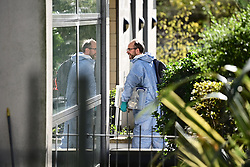 © Licensed to London News Pictures. 06/10/2020. London, UK. Police forensics are seen entering a residential property on Clayponds Lane, Brentford where the bodies of two people, a woman and a child were discovered. A man, believed aged in his 40s, was found suffering stab injuries. Photo credit: Ben Cawthra/LNP