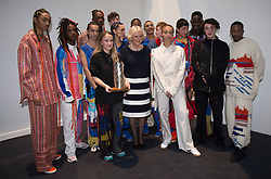 The Duchess of Cornwall (centre) with models, executives and officials after presenting designer Bethany Williams (centre left) with the Queen Elizabeth II Award for Design during a visit to London Fashion Week at the BFC Show Space, London.