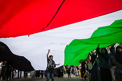 June 23, 2017 - Central Jakarta, Jakarta, Indonesia - A little boy under a large Palestinian flag during a pro-Palestinian rally marking the International Al-Quds (Jerusalem Day) Day outside the U.S. Embassy in Jakarta, Indonesia. Al Quds Day (Jerusalem Day) is an annual event held on the last Friday of Ramadan that was initiated by the Islamic Republic of Iran in 1979 to express support for the Palestinians and oppose Zionism and Israel, as well as Israel's occupation of Jerusalem and Jewish settlements in Israeli-occupied territories. (Credit Image: © Afriadi Hikmal via ZUMA Wire)