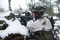 23 FEB 2013, LETZLINGEN/GERMANY:<br /> Schuetze mit Gewehr G36 mit AGDUS, Ausbildungsgeraet Duellsimulator, in Wintertarnung waehrend einer Gefechtsuebung der Panzergrenatiere im Winter, Gefechtsuebungszentrum Heer, Truppenuebungsplatz Altmark<br /> IMAGE: 20130223-01-044<br /> KEYWORDS: Gefechtsübung, Schnee, Soldat, Gefechtsübungszentrum, Heer, Armee, Streikräfte, Militaer, Miltär, Streitkraefte, Streitkräfte, Schütze