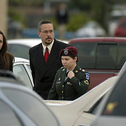 Fort Hood, Texas: PFC Lynndie R. England arrives at the military courhouse at Fort Hood, Texas Monday morning with her attorneys for the first day of her trial in the Abu Ghraib prison scandal in Iraq. May 2, 2005 ©Bob Daemmrich