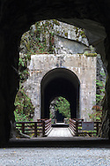 A bridge over the Coquihalla River and two of the Othello Tunnels in Coquihalla Canyon Provincial Park near Hope, British Columbia, Canada.  These paths and tunnels were part of the Kettle Valley Railway which ran from Hope to Midway in British Columbia.  The tunnels and railway were constructed in 1914 and are also known as the Quintette tunnels.