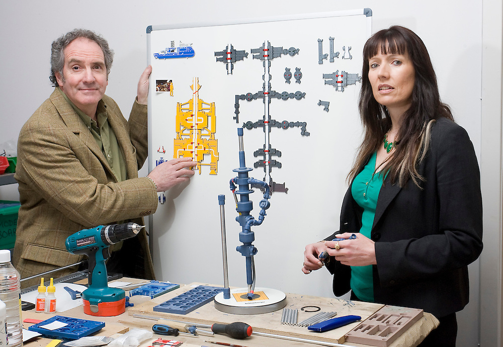 Marketek WISE-Board models can incorporate a significant level of detail, this combined with an easily read schematic detailing internal functions, helps provide efficient recognition and understanding of complex processes or equipment configurations. ..Pic of Bruce Adam managing director Marketec demonstrating a WISE-Board model of a wellhead holding; with Karen Stewart a business adviser from Business Gateway  standing next to a MAGNA-Tec model which is machined from a high-grade polymer and assembled with unique magnetic connections.