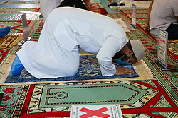 © Licensed to London News Pictures. 31/07/2020. London, UK. A worshipper prays at Wightman Road Mosque, also known as London Islamic Cultural Society and Mosque, in north London as Muslims celebrate the festival of Eid. Last month the government announced that gatherings of more than 30 worshippers are allowed for acts of communal worship in churches, synagogues, mosques, temples and other places of worship. All worshippers attending Mosques for Eid celebrations have to wear face coverings and bring their own prayer mat, Quran, and a reusable shoe bag. Eid al-Adha, also called Eid Qurban or Bakra-Eid, is the second of two Islamic holidays celebrated worldwide each year, and considered the holier of the two. Photo credit: Dinendra Haria/LNP