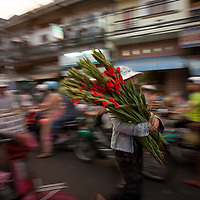 A busy, crowded street scene in Ho Chi Minh City, Vietnam.