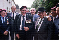 Pictured centre is British General Mad Mike Calvert, on to the right in the bowler hat is French General George Berge, alongside other veterans. Photographed by Terry Fincher