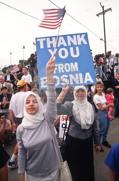Bosnian Muslim women show support for President Bill Clinton during a campaign stop for his re-election August 28, 1996 in Royal Oak, MI