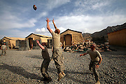 Embedded with the US Army, 3rd brigade combat team, 10th Mountain division in the highly volatile Logar province of Afghanistan in early May 2009...Photo: Guilad Kahn. ..Soldiers play during down time before going on a mission at FOB Altimur..