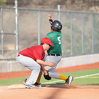 Third baseman for the Angels Camren McDaugale, left, tags runner Isaiah Roseth out at third base on the attempted steal for the Athletics in the Pee Wee Reese league at Ford Canyon Park Friday, May 31 in Gallup.