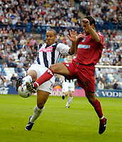 Photo: Ed Godden.<br />West Bromwich Albion v Colchester United. Coca Cola Championship. 19/08/2006. Nigel Quashie (L) is challenged by Colchester's Chris Backer.