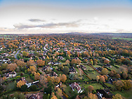 The village of West Chiltington in West Sussex, England in autumn aerial view