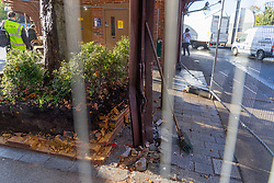 Buckled steel pillars are seen behind Metal barriers sealing off the bus shelter and destroyed planter following Sunday's bus crash in which 19 people were injured including a teenage girl who is in critical condition. The bus driver was arrested on suspicion of drug driving. Croydon, South London November 12 2018.