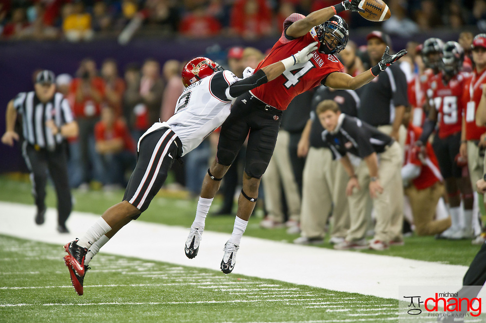 Louisiana-Lafayette's Javone Lawson WR (4) attempts to catch a pass during the R+L Carriers New Orleans Bowl at the Mercedes-Benz Superdome.  Louisiana-Lafayette defeated San-Diego State 32-30. (Copyright Michael Chang)