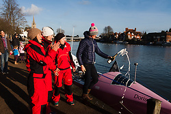 Marlow, Bucks, January 24th 2015. Olympic and Paralympic rowing medallists including Naomi Riches, Heather Stanning and Katherine Grainger join members of a Coxless Crew at Marlow at their boat naming ceremony. The Coxless Crew is a team of four women who have given up their jobs to undertake an epic six-month 8,446 mile adventure rowing their boat Doris across the Pacific ocean from Sanfrancisco to Cairns in Australia, to raise funds for charities Walking With The Wounded and Breast Cancer Care. PICTURED: Olympic Gold medallist Heather Stanning pours champagne on the bow of Doris during the boat's naming ceremony.