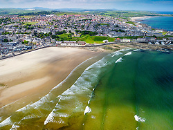 Aerial view from drone of beach and coastline at Banff on Moray Firth coast in Aberdeenshire, Scotland, UK