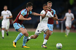 Burnley's Kevin Long (left) and Leeds United's Kemar Roofe battle for the ball during the Carabao Cup, third round match at Turf Moor, Burnley.