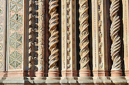Medieval sculpted decorative columns on the14th century Tuscan Gothic style facade of the Cathedral of Orvieto, designed by Maitani, Umbria, Italy .<br /> <br /> Visit our ITALY HISTORIC PLACES PHOTO COLLECTION for more   photos of Italy to download or buy as prints https://funkystock.photoshelter.com/gallery-collection/2b-Pictures-Images-of-Italy-Photos-of-Italian-Historic-Landmark-Sites/C0000qxA2zGFjd_k<br /> .<br /> <br /> Visit our MEDIEVAL PHOTO COLLECTIONS for more   photos  to download or buy as prints https://funkystock.photoshelter.com/gallery-collection/Medieval-Middle-Ages-Historic-Places-Arcaeological-Sites-Pictures-Images-of/C0000B5ZA54_WD0s