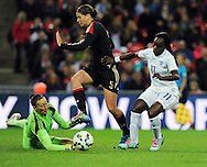 Eniola Aluko of England Women is challenged by Germany Women goalkeeper Almuth Schult and Annike Krahn of Germany Women<br /> - Womens International Football - England vs Germany - Wembley Stadium - London, England - 23rdNovember 2014  - Picture Robin Parker/Sportimage