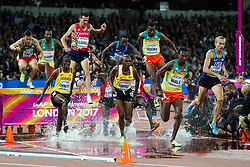 London, August 08 2017 . Evan Jager, USA, leads the field on lap 2 in the men's 3,000m steeplechase final on day five of the IAAF London 2017 world Championships at the London Stadium. © Paul Davey.