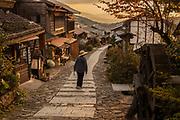 Pilgrim at end of day's walk between Magome and Tsumago, old post road between Kyoto and Tokyo, Northern Japan Alps, Japan,