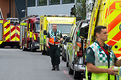 ©Licensed to London News Pictures 16/07/2020     <br /> Bromley, UK. A long line of emergency vehicles. A large emegency response in Bromley town Centre as two people are taken unwell. A Bromley address has been evacuated due to a suspicious package, Firefighters with breathing apparatus have been seen at the back of an office building. Photo credit: Grant Falvey/LNP