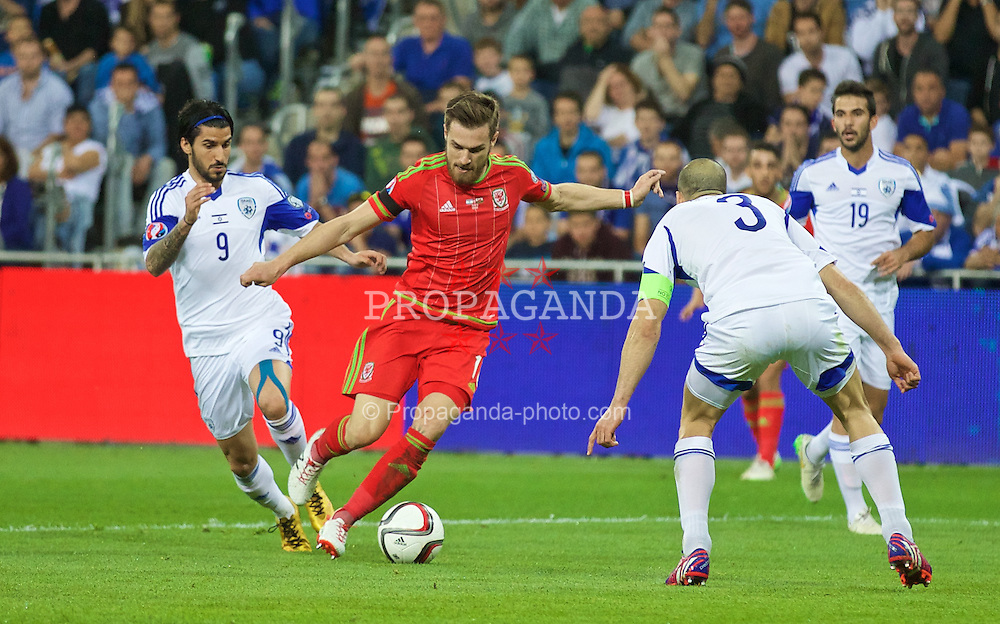 HAIFA, ISRAEL - Saturday, March 28, 2015: Wales' Aaron Ramsey in action against Israel during the UEFA Euro 2016 qualifying Group B match at the Sammy Ofer Stadium. (Pic by David Rawcliffe/Propaganda)