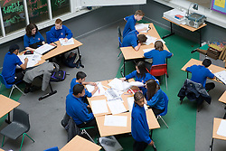 Aerial view of students studying in classroom,
