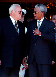 March 10, 1998 - Cape Town, South Africa - NELSON MANDELA, the South African President talks to his guest, German President Dr. ROMAN HERZOG, as they walk in the garden, in front of Presidential offices in Cape Town. German President is in a four day official visit to South Africa. (Credit Image: © Sasa Kralj/JiwaFoto/ZUMAPRESS.com)