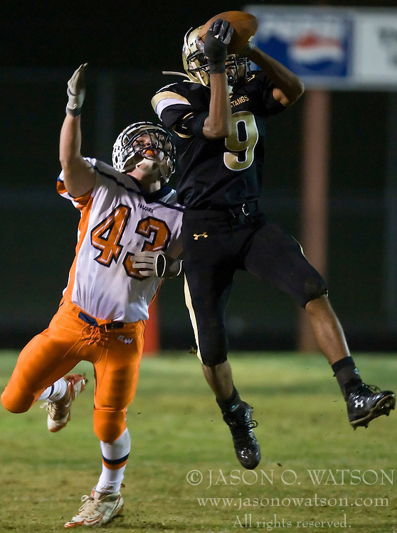 Monticello's Marvin Mills (9) breaks up a pass intended for Briar Woods' Jake Ashton (43).  The Monticello High School Mustangs faced the Briar Woods High School Falcons in the first round of the Group AA Region II playoffs at Monticello HS in Charlottesville, VA on November 14, 2008.  Briar Woods HS led 13-10 at the half.  (Special to the Daily Progress / Jason O. Watson)