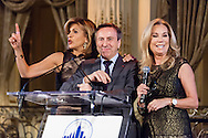 Hoda Kotb, Daniel Boulud, and Kathie Lee Gifford hold a live auction at the Citymeals-on-Wheels 28th Annual Power Lunch for Women, November 21, 2014, at the Plaza Hotel.