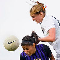 110812       Cable Hoover<br /> <br /> Kirtland Central Bronco Hanalysa Thompson (7) and Aztec Tiger Kayli Farmer (22) compete for a header during state tournament play Thursday at the APS Soccer Complex in Albuquerque