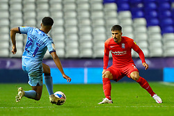 Birmingham City's Maxime Colin watches as Sam McCallum of Coventry City (on loan from Norwich City) lunges for the ball - Mandatory by-line: Nick Browning/JMP - 20/11/2020 - FOOTBALL - St Andrews - Birmingham, England - Coventry City v Birmingham City - Sky Bet Championship