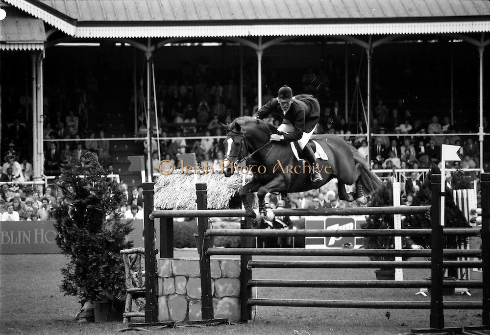 """07/08/1987<br /> 08/07/1987<br /> 07 August 1987<br /> Bank of Irelands Nations Cup for the Aga Khan trophy competition. Eddie Macken (Ireland) on """"Carroll's Flight""""."""